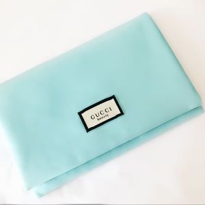 GUCCI light blue cosmetic / jewelry pouch NWT